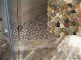 Mixed bathroom pebble tile