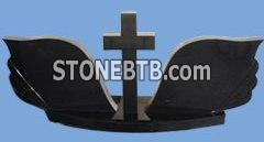 black cross and wing headstone