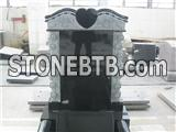 Traditional black granite headstone with kerbs