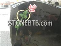 Black granite monument with flower mosaic
