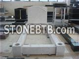 White marble monument with kerbs