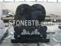 Heart shaped granite monument with kerbs