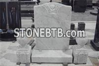 White marble headstone grave markers with vases