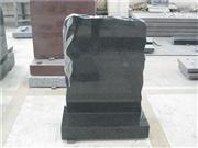 Black headstone with leaf carving gravestone