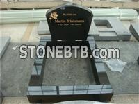Black polished headstone with kerbset