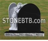 Black granite headstone with angel monument