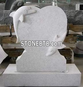 white marble headstone dolphin tombstone