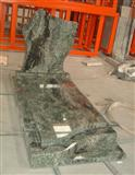 Green granite tombstone