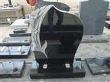 Black polished tombstone and monument
