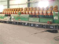 Automatic polishing machine for marble slabs