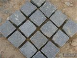 Dark grey granite paving pattern