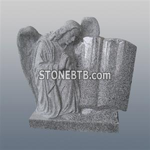 G603 carved angel and book tombstone