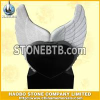 white headstone with wings