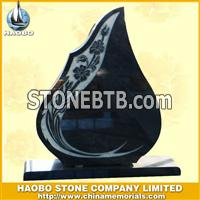 black sculptured tombstone