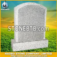gray gravestone with rockpitch