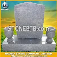 gray headstone with vases