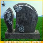 German granite tombstone with rose carved