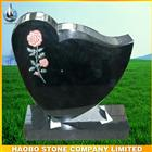 flower carved black granite headstone