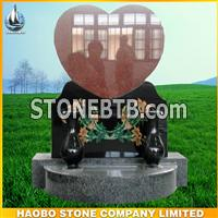 red granite heart headstone with carving