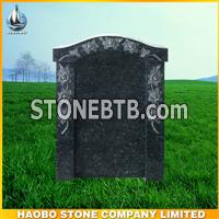 new granite headstone with flower carving