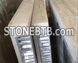 Stone honeycomb panels for wall envelope