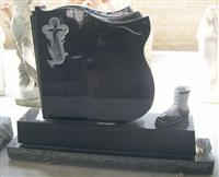 carving black cross tombstone