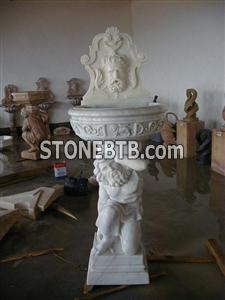 Stone Fountain With Characters Carved