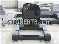 Black granite anton shaped headstone with rose carving