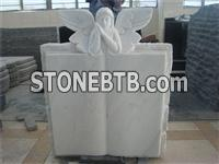 White marble angel book shaped headstone