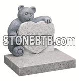 White granite teddy bear carving with heart child tombstone