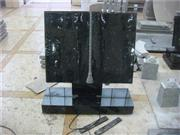Black granite book shaped tombstone