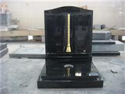 Black granite book shaped monument with cover slab