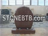 Brown granite round top headstone with rose carvings