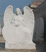 White marble angel with heart headstones
