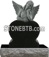 Black granite angel with heart design tombstone