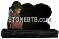 Black granite heart shaped headstone with angel etching