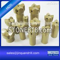 Cross bits for rock drilling