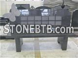 Granite memorial bench with butterfly carving
