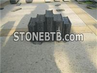 Granite tombstone with book carving
