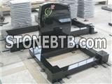 black granite tombstone with rose shadow