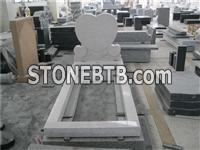granite heart shaped headstone with carved