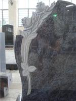 European style granite tombstone with carved rose
