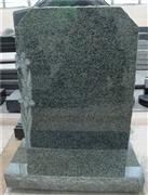 European style granite headstone with lily carving