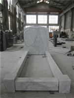 European style marble headstone with bow carving