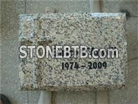 Granite tablet with carved cross
