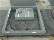 European style book shape granite tombstone with kerb