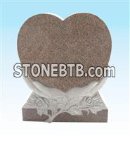 heart shaped granite monument with carving