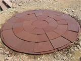 Red sandstone circle pavement