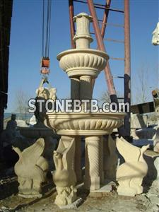 carved yellow limestone fountain