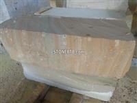 Yellow wood grain sandstone blocks